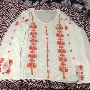 White sheer blouse with an embroidered design